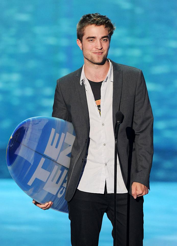 """BEST: Robert Pattinson Makes It Work — We're always worried for RPatz at this type of thing — award shows aren't exactly his strong suit, and he was seriously sweating through his Cancer Bites speech because some grossly tacky teenage girls wouldn't stop screaming. But then he won Best Dramatic Actor and really surprised us — first with an honest joke (""""Teenagers are scary!""""), and then by giving thanks to the author of """"Water for Elephants"""" and to the director, crew, and fans. """"I'm glad you guys liked it,"""" he finished. It may be the only thing we end up remembering about that movie."""