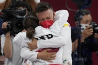 Sandra Sanchez Jaime of Spain hugs her husband and coach Jesus del Moral after winning the women's kata final bout for Karate at the 2020 Summer Olympics, Thursday, Aug. 5, 2021, in Tokyo, Japan. (AP Photo/Vincent Thian)