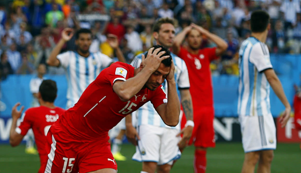 Switzerland's Blerim Dzemaili reacts after missing a chance to equalise against Argentina in extra time during their 2014 World Cup round of 16 game at the Corinthians arena in Sao Paulo July 1, 2014. REUTERS/Eddie Keogh (BRAZIL - Tags: SOCCER SPORT WORLD CUP)
