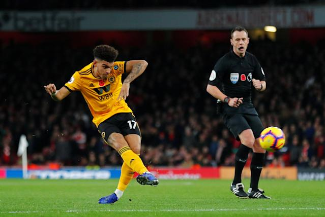 """Soccer Football - Premier League - Arsenal v Wolverhampton Wanderers - Emirates Stadium, London, Britain - November 11, 2018 Wolverhampton Wanderers' Morgan Gibbs-White hits the crossbar with a shot REUTERS/Eddie Keogh EDITORIAL USE ONLY. No use with unauthorized audio, video, data, fixture lists, club/league logos or """"live"""" services. Online in-match use limited to 75 images, no video emulation. No use in betting, games or single club/league/player publications. Please contact your account representative for further details."""
