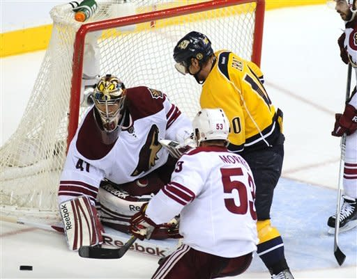 Phoenix Coyotes goalie Mike Smith (41) stops the shot of Nashville Predators right wing Martin Erat (10), of the Czech Republic, in the second period of Game 4 in an NHL hockey Stanley Cup Western Conference semifinal playoff series, Friday, May 4, 2012, in Nashville, Tenn. (AP Photo/Mike Strasinger)