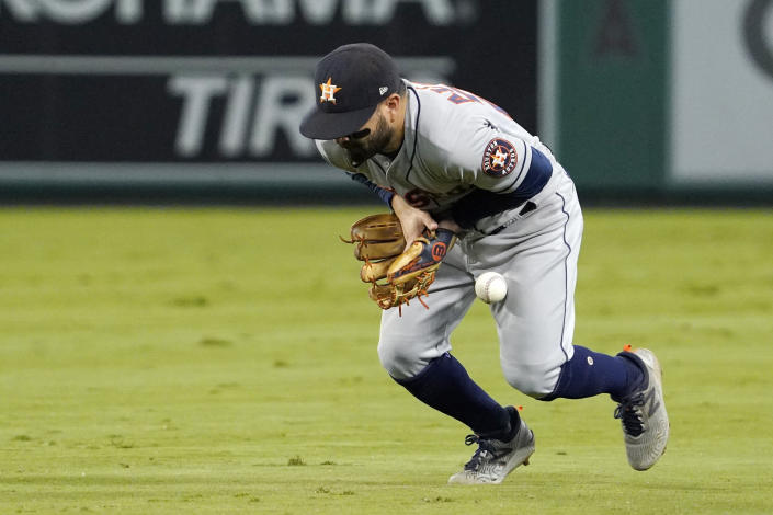 RETRANSMISSION TO CORRECT NAME FROM JACK MAYFIELD TO JOSE ROJAS - Houston Astros second baseman Jose Altuve bobbles a ball hit by Los Angeles Angels' Jose Rojas during the sixth inning of a baseball game Thursday, Sept. 23, 2021, in Anaheim, Calif. Rojas was safe at first on the play and Altuve was charged with an error. (AP Photo/Mark J. Terrill)