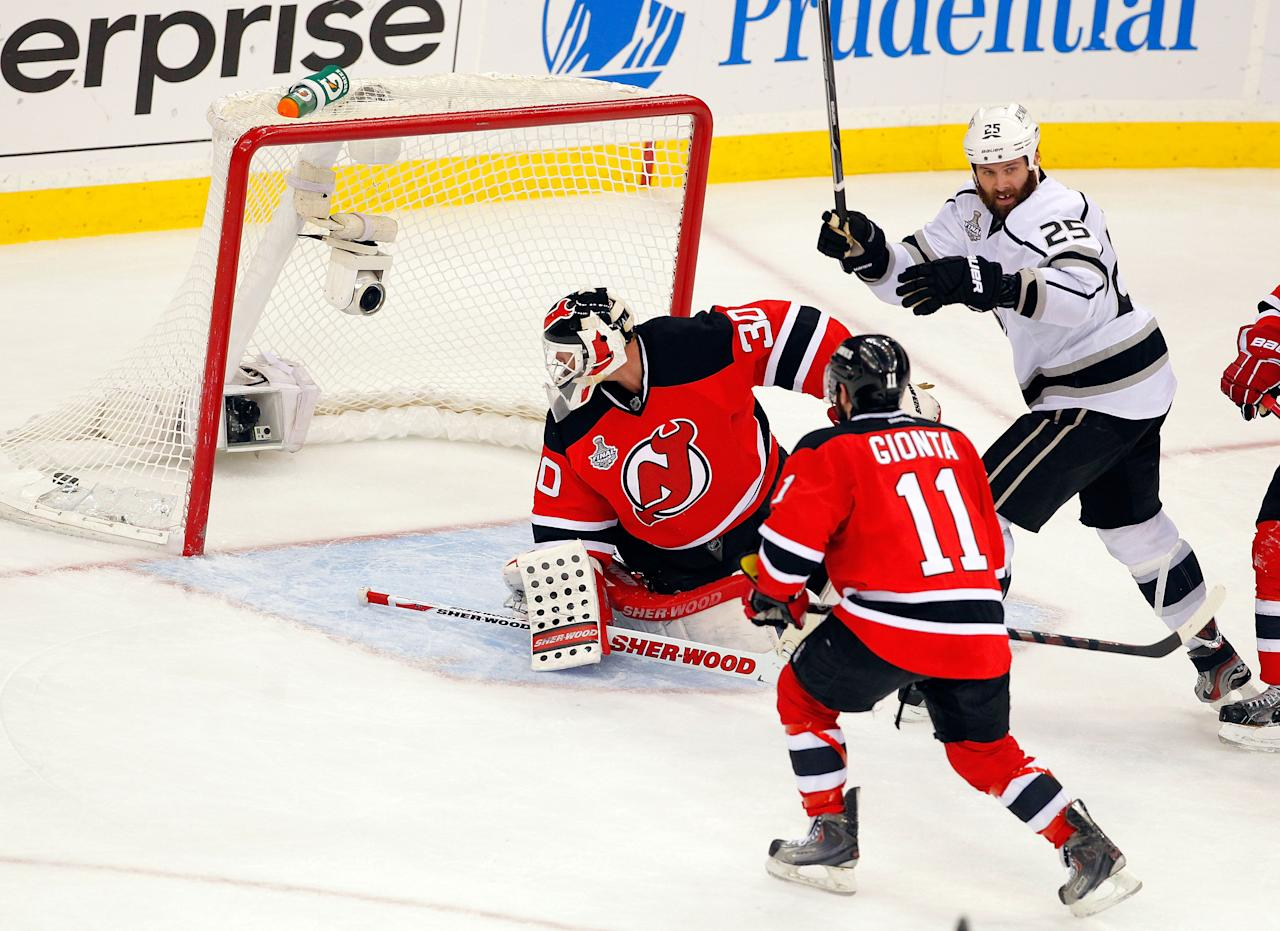 NEWARK, NJ - JUNE 02:  Martin Brodeur #30 of the New Jersey Devils allows the game winning goal in overtime from Jeff Carter #77 of the Los Angeles Kings (not pictured) as Dustin Penner #25 celebrates and Stephen Gionta #11 looks on during Game Two of the 2012 NHL Stanley Cup Final at the Prudential Center on June 2, 2012 in Newark, New Jersey.  (Photo by Paul Bereswill/Getty Images)