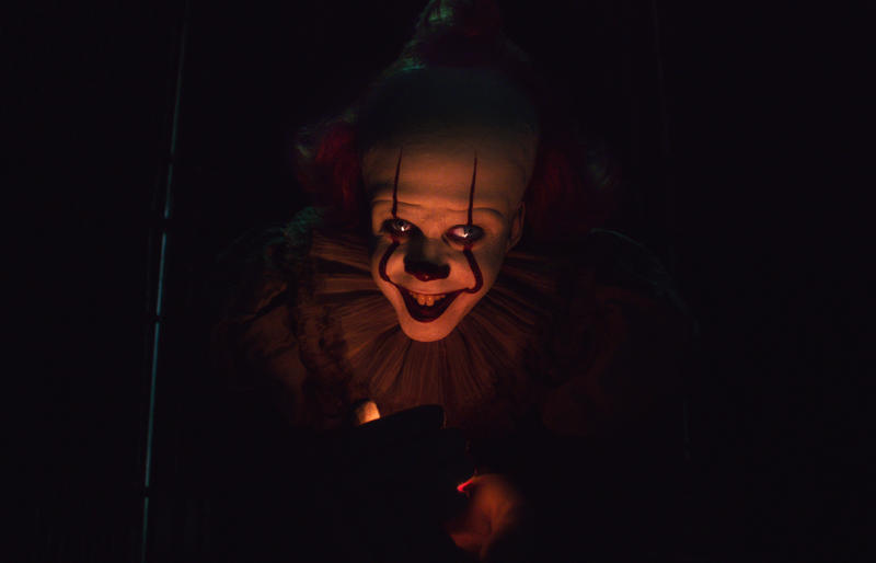 """This image released by Warner Bros. Pictures shows Bill Skarsgard as Pennywise in New Line Cinema's horror thriller """"It: Chapter 2."""" The film brought in $40.7 million to keep the top spot in its second week and has earned a total of $153.8 million. The original had earned more than $200 million at the same point two years ago.  (Warner Bros. Pictures via AP)"""