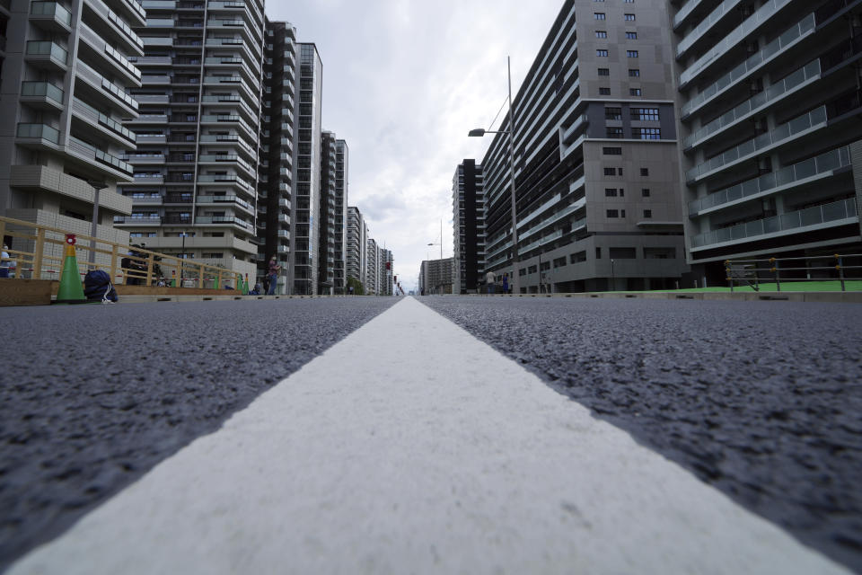 FILE - In this June 20, 2021, file photo, a road at the Tokyo 2020 Olympic and Paralympic Village is seen, in Tokyo. The Tokyo Olympics are not looking like much fun: Not for athletes. Not for fans. And not for the Japanese public, who are caught between concerns about the coronavirus at a time when few are vaccinated on one side and politicians and the International Olympic Committee who are pressing ahead on the other. (AP Photo/Eugene Hoshiko, File)