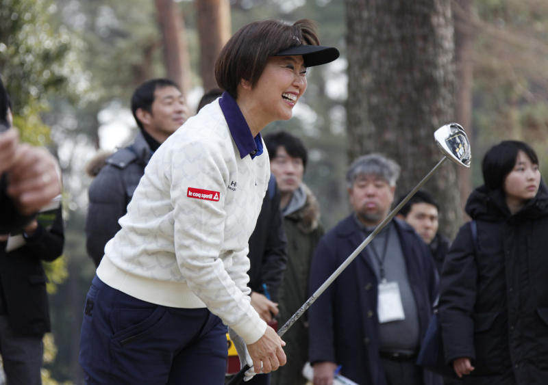 "Japanese golf player Hiromi Kobayashi reacts after her shot during a media tour of Kasumigaseki Country Club golf course, one of the venues of the Tokyo 2020 Olympics, in Kawagoe, near Tokyo, Monday, Feb. 25, 2019. Kobayashi was the LPGA's rookie of the year in 1990 and she says Japan faces high expectations. She says ""as a player I was representing myself. But this is a different kind of pressure"" for the country and its golfing community. (AP Photo/Koji Sasahara)"