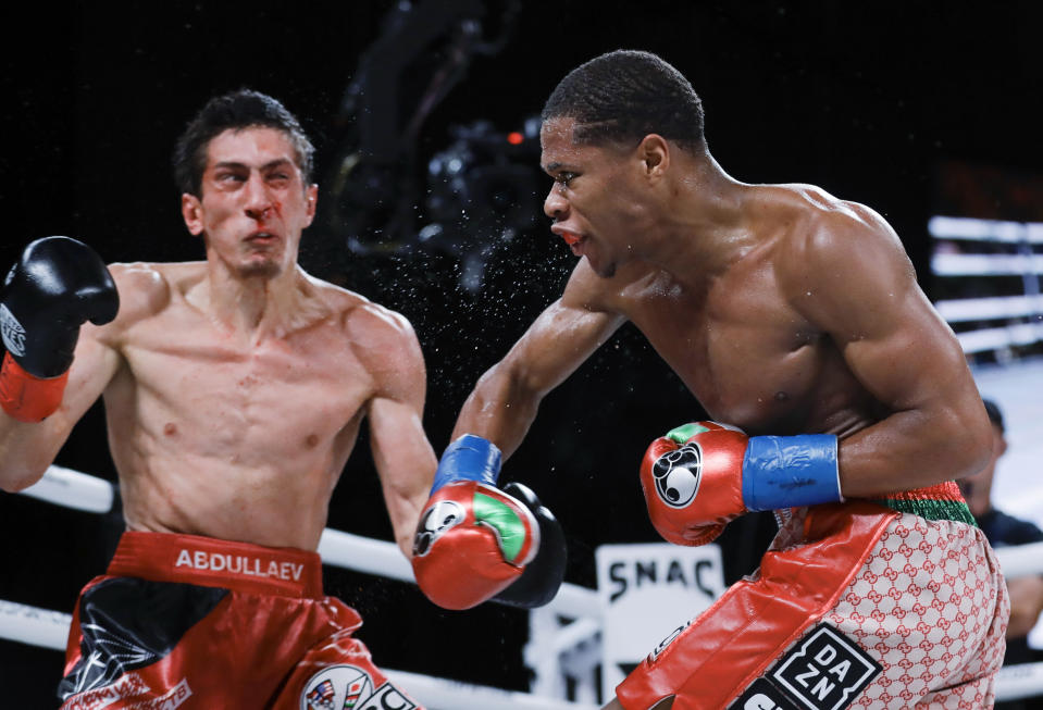 Devin Haney, right, follows through on a right to Russia's Zaur Abdullaev during the fourth round of the WBC interim lightweight boxing match Friday, Sept. 13, 2019, in New York. Haney won in four rounds. AP Photo/Frank Franklin II)