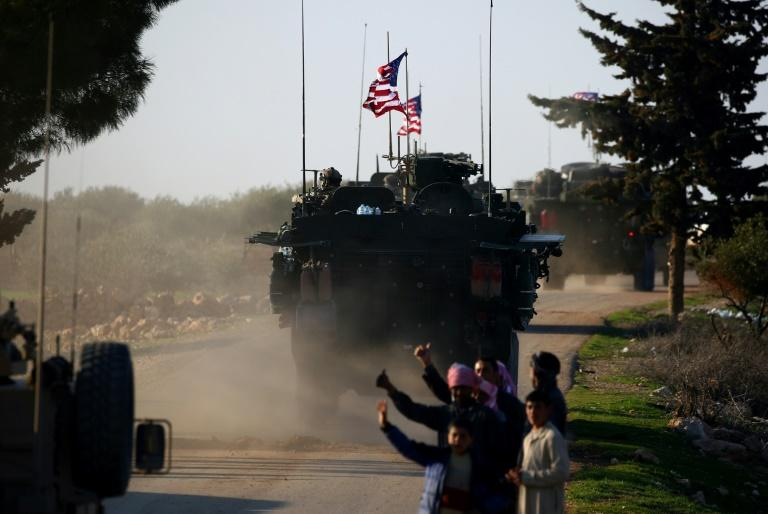 Another 400 US troops are being deployed in Syria against IS jihadists who are also facing a huge offensive in Iraq