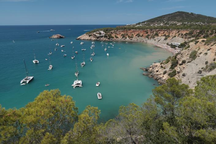 Cala d'Hort beach is a popular destination for British holidaymakers wanting to watch the Ibizan sunset (Sean Gallup/Getty Images)