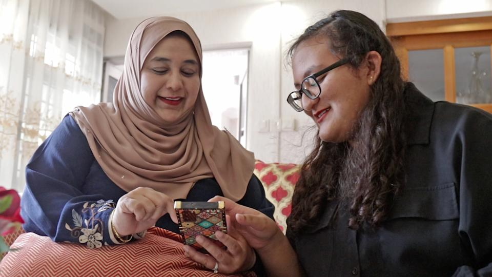 Habibah Tahar (left) and her 16-year-old daughter Salwa Taib Ali, who received her first dose of the COVID-19 vaccine on Thursday (3 June). (PHOTO: Dhany Osman / Yahoo News Singapore)