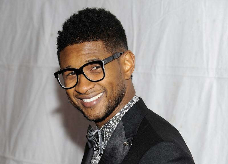 "FILE - This Nov. 17, 2011 file photo shows singer Usher Raymond at the ""Pencils Of Promise"" inaugural gala in New York. Usher is stepping into the boxing ring to portray Sugar Ray Leonard in the new film ""Hands of Stone.""  Usher says he has spent more than a year preparing to play Leonard, who was known for his fast hands, quick feet and wide smile. (AP Photo/Evan Agostini, file)"