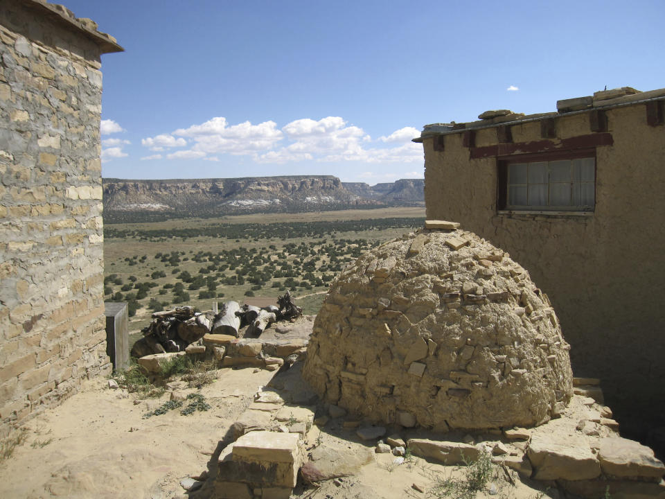 FILE - This October 2012 photo shows a view from the Acoma Pueblo in New Mexico. The ancient pueblo has been inhabited for centuries by the Acoma people. The location is featured in a collection of mini-essays by American writers published online by the Frommer's guidebook company about places they believe helped shape and define America. (AP Photo/Beth J. Harpaz, File)