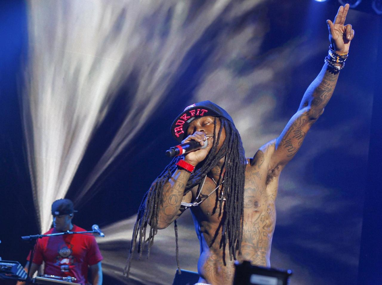 In this March 15, 2012 image, Lil Wayne performs during the SXSW Music Festival in Austin, Texas.(AP Photo/Jack Plunkett)