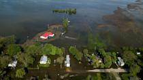 <p>Water from the swelling Mississippi River covers roadways and surrounds houses on Saturday, May 4, 2019 in Foley, Mo.</p>