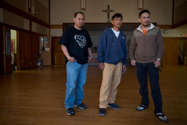 Left to right: Arthur Jemmy, Harry Pangemanan and Johanes Tasik took refuge in the Reformed Church of Highland Park on Jan. 31, 2018. (Photo: Alan Chin for Yahoo News)