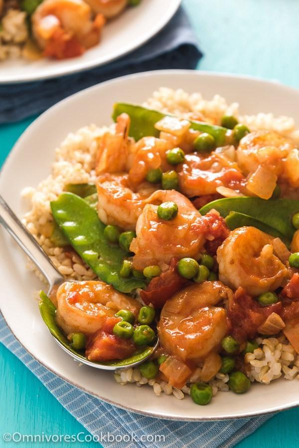 """<p>This is a classic Chinese stir fry dish that can be on your dinner table in just 15 minutes. Chop it up, fry it up - and watch your kids gobble it up. <i>[Image: Omnivore's Cookbook]</i></p><p>Get the recipe from: <b><a rel=""""nofollow noopener"""" href=""""http://omnivorescookbook.com/tomato-shrimp-stir-fry"""" target=""""_blank"""" data-ylk=""""slk:Omnivore's Cookbook"""" class=""""link rapid-noclick-resp"""">Omnivore's Cookbook</a></b></p>"""
