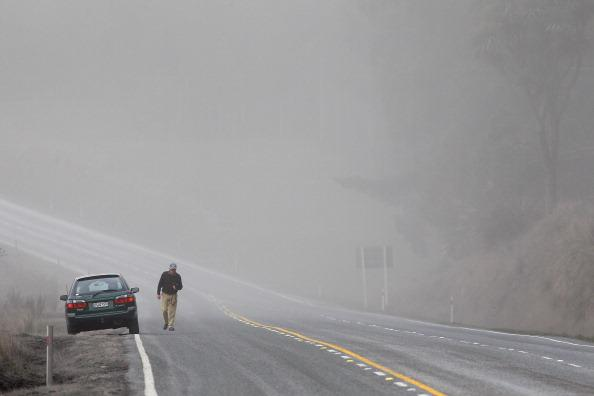 A motorist is surrounded by a cloud of ash on state highway one after Mt Tongariro erupted for the first time in over 100 years on August 7, 2012 in Tongariro National Park, New Zealand. Mt Tongariro erupted intermittently from 1855 to 1897. Although not an immediate threat to the community, the latest eruption may be the beginning of weeks, months or even years of volcanic activity. (Photo by Hagen Hopkins/Getty Images)