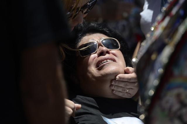 <p>Lucyvette Padro grieves during the burial of her son Angel Candelario Padro, a 28-year-old nurse and National Guard member, as he is laid to rest at the Guanica municipal cemetery in Puerto Rico, June 18, 2016. (AP Photo/Carlos Giusti) </p>