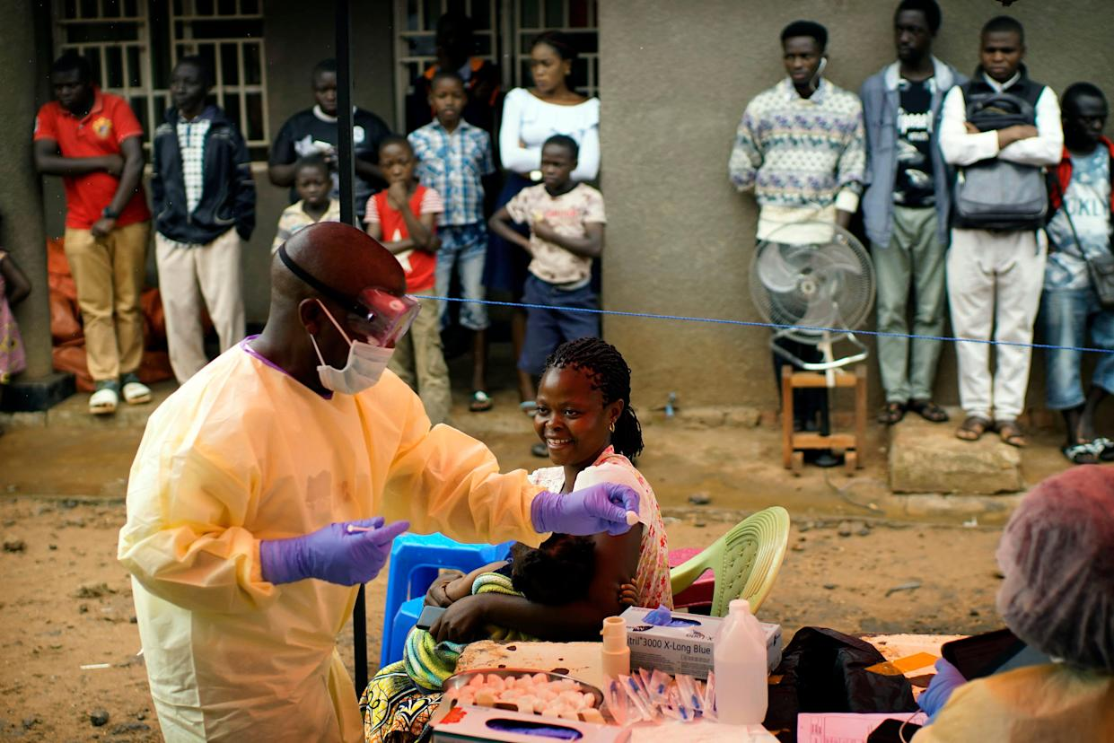 In this photo taken on Saturday, July 13, 2019, a nurse vaccinates a child against Ebola in Beni, Congo DRC. The World Health Organization has declared the Ebola outbreak an international emergency after spreading to eastern Congo's biggest city, Goma, this week.