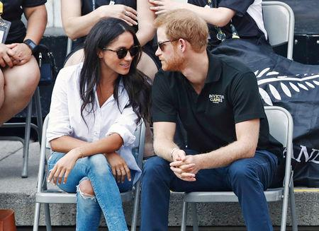 FILE PHOTO: Britain's Prince Harry arrives with girlfriend actress Meghan Markle at the wheelchair tennis event during the Invictus Games in Toronto