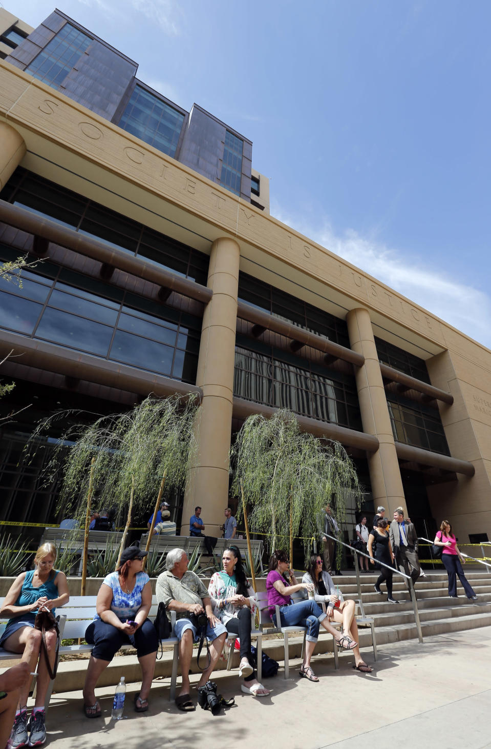 People gather outside Superior Court, Wednesday, May 8, 2013 in downtown Phoenix. Jurors reached a verdict Wednesday in the trial of Jodi Arias, who is accused of murdering her one-time boyfriend in Arizona. Arias is charged with first-degree murder in the June 2008 death of Travis Alexander, a motivational speaker and salesman, at his suburban Phoenix home. (AP Photo/Matt York) (AP Photo/Matt York)