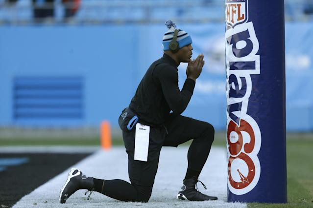 Carolina Panthers' Cam Newton pauses by a goal post as he warms up before an NFL football game against the Tampa Bay Buccaneers in Charlotte, N.C., Sunday, Dec. 1, 2013. (AP Photo/Chuck Burton)