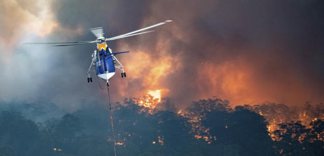 A helicopter tackles a wildfire in East Gippsland, Victoria. (State Government of Victoria/AP)