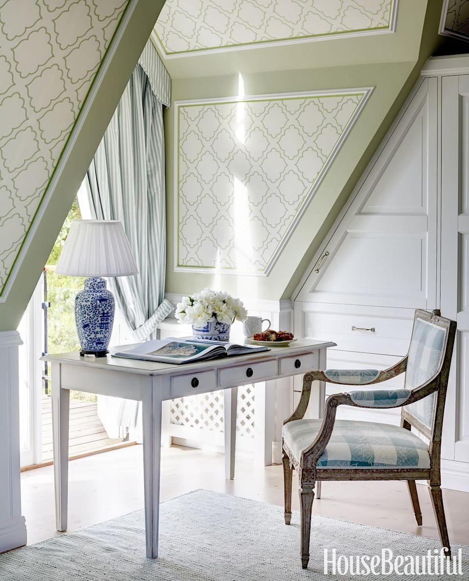 """<p>Pare way down and keep your aesthetic clean and calming. A simple Swedish desk was placed by a window with a view of the Baltic Sea in a <a href=""""https://www.housebeautiful.com/design-inspiration/house-tours/g3257/marshall-watson-swedish-summer-house-tour/"""" rel=""""nofollow noopener"""" target=""""_blank"""" data-ylk=""""slk:Scandinavian home"""" class=""""link rapid-noclick-resp"""">Scandinavian home</a>. It's mostly neutral, but the pops of blue keep the room feeling fresh and invigorating. </p>"""