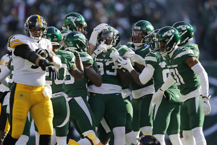 New York Jets linebacker Tarell Basham (93) celebrates an interception with teammates in the first half of an NFL football game against the Pittsburgh Steelers, Sunday, Dec. 22, 2019, in East Rutherford, N.J. (AP Photo/Adam Hunger)