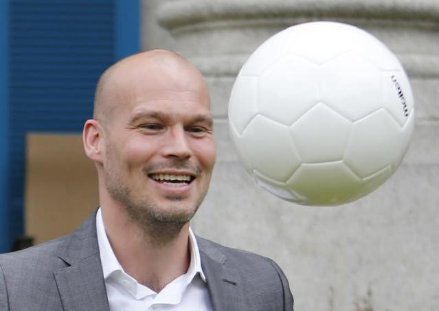 Arsenal club ambassador and former player Ljungberg juggles a soccer ball while promoting Arsenal's Asia Tour in Tokyo