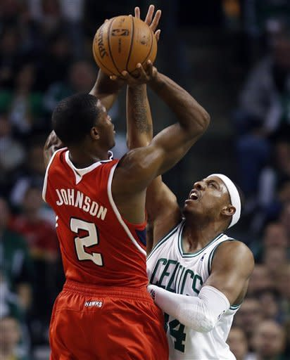 Atlanta Hawks' Joe Johnson (2) shoots over Boston Celtics' Paul Pierce (34) during the first quarter of Game 4 of an NBA basketball first-round playoff series, in Boston on Sunday, May 6, 2012. (AP Photo/Michael Dwyer)