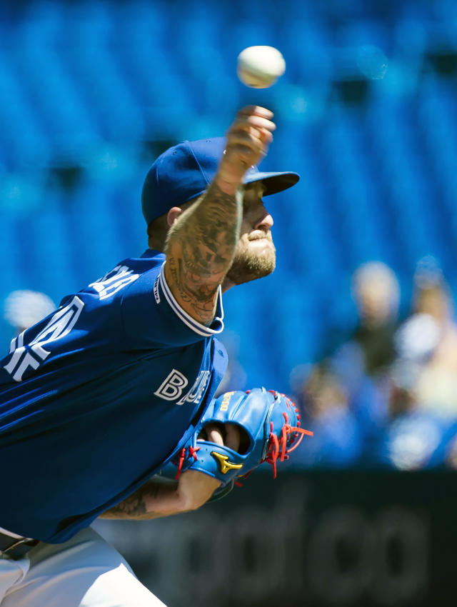 Toronto Blue Jays starting pitcher Sean Reid-Foley (54) works against the Texas Rangers during the first inning of a baseball game in Toronto, Wednesday, Aug. 14, 2019. (Nathan Denette/The Canadian Press via AP)