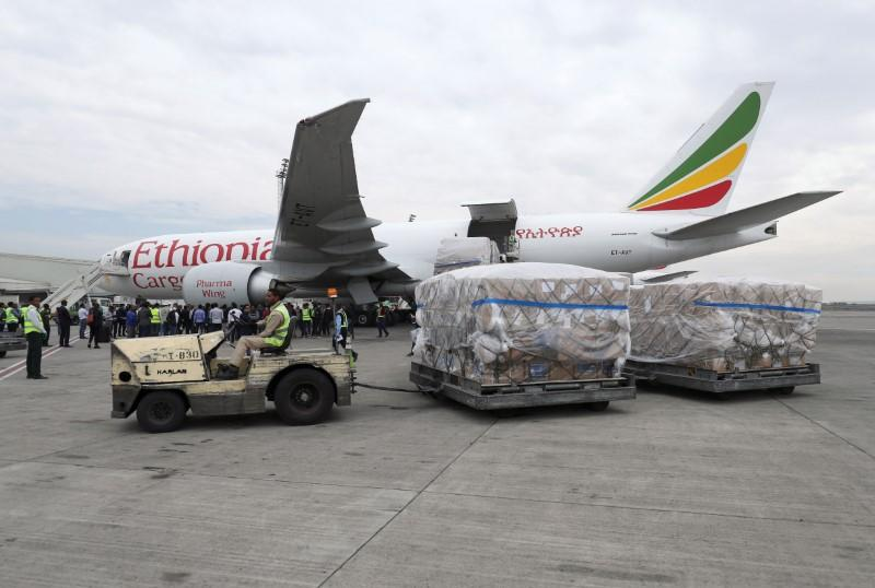 Ethiopian Airlines worker transports a consignment of medical donation from Chinese billionaire Jack Ma and Alibaba Foundation to Africa in Addis Ababa