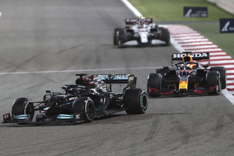 Mercedes driver Lewis Hamilton of Britain steers his car followed by Red Bull driver Max Verstappen of the Netherlands during the Bahrain Formula One Grand Prix at the Bahrain International Circuit in Sakhir, Bahrain, Sunday, March 28, 2021. (AP Photo/Kamran Jebreili)