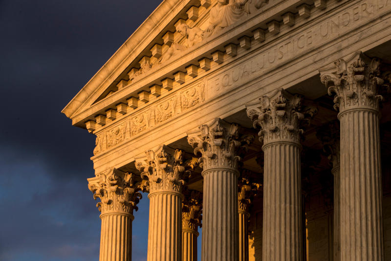 FILE - In this Oct. 10, 2017, file photo, the Supreme Court in Washington is seen at sunset. (AP Photo/J. Scott Applewhite, File)