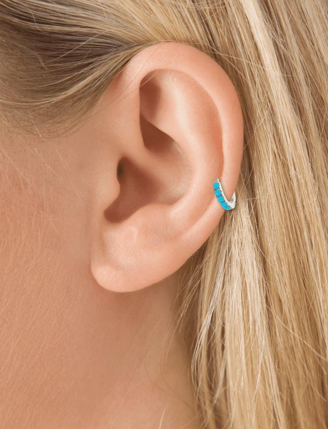 <p>The beautiful shade of <span>Maria Tash's Turquoise Eternity Clicker</span> ($410) matches with both Jasmine's gemstone headband and Pocahontas's sculptural choker.</p>