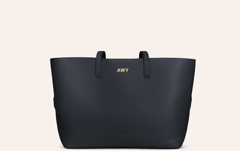 """<h3>Away Latitude Tote</h3><br>Add their initials to this useful and stylish tote bag for a stand-out piece that makes a statement.<br><br><em>Shop </em><strong><em><a href=""""https://www.awaytravel.com/"""" rel=""""nofollow noopener"""" target=""""_blank"""" data-ylk=""""slk:Away"""" class=""""link rapid-noclick-resp"""">Away</a></em></strong><br><br><strong>Away</strong> Latitude Tote, $, available at <a href=""""https://go.skimresources.com/?id=30283X879131&url=https%3A%2F%2Fwww.awaytravel.com%2Ftravel-bags%2Flatitude-tote%2Fnavy-leather"""" rel=""""nofollow noopener"""" target=""""_blank"""" data-ylk=""""slk:Away"""" class=""""link rapid-noclick-resp"""">Away</a>"""