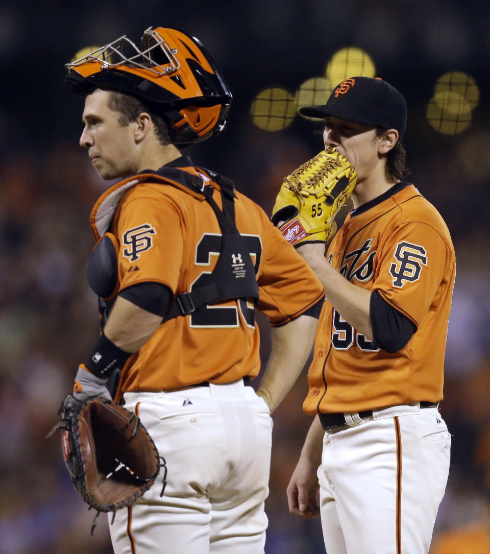 San Francisco Giants' Tim Lincecum, right, waits to be removed from the baseball game against the Los Angeles Dodgers in the fifth inning Friday, July 25, 2014, in San Francisco. At left is catcher Buster Posey. (AP Photo)