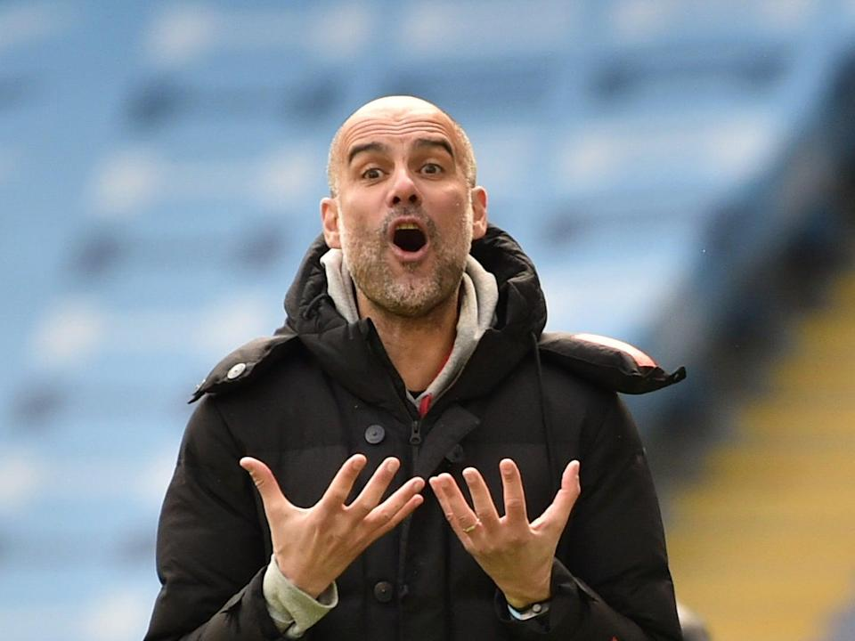Manchester City coach Pep Guardiola reacts during his team's loss to Leeds (Getty Images)