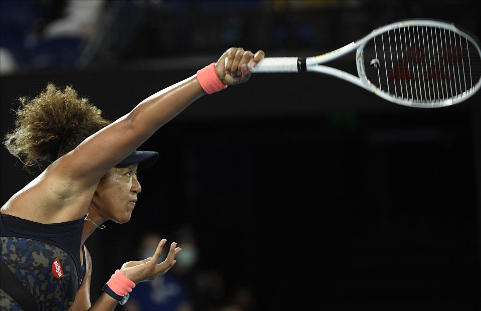 Japan's Naomi Osaka serves to United States' Jennifer Brady during the women's singles final at the Australian Open tennis championship in Melbourne, Australia, Saturday, Feb. 20, 2021.(AP Photo/Andy Brownbill)