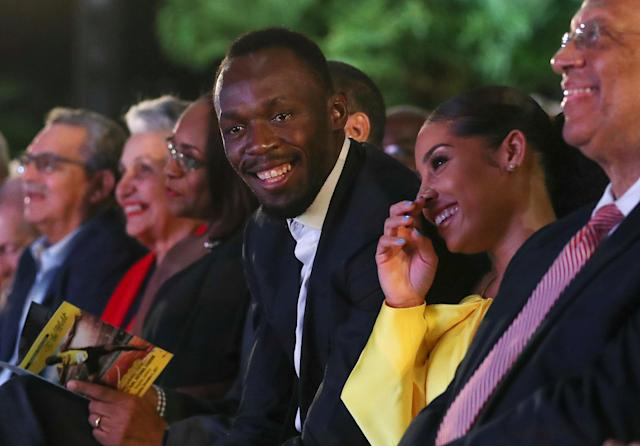 Olympic champion Usain Bolt (C) and his girlfriend Kasi Bennett (2nd R) attend a ceremony for the unveiling of Bolt's statue at the Statue Park at the National Stadium, in Kingston, Jamaica December 3, 2017. REUTERS/Gilbert Bellamy