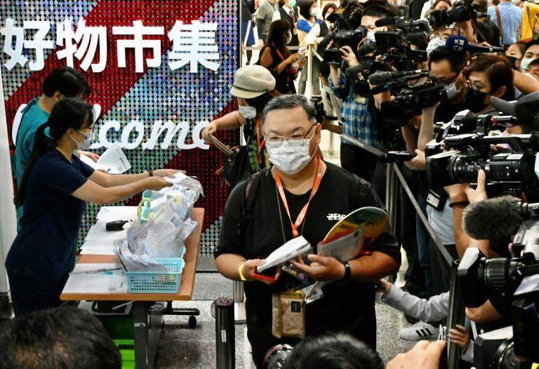 Taiwan tourists queue for Covid-19 tests before their flight to Palau. Taiwanese authorities said they all tested negative