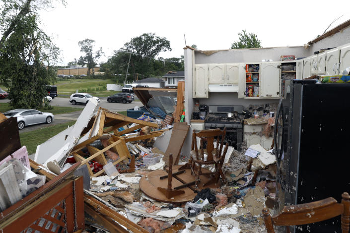 Household items litter the floor of a severely damaged house after a tornado passed through the area on Monday, June 21, 2021, in Woodridge, Ill. (AP Photo/Shafkat Anowar)