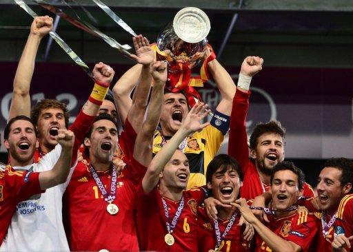 Spanish players celebrate with the trophy