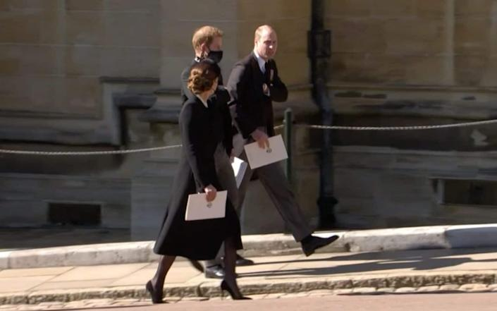 Prince Harry and William chat following the service at Windsor