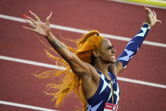 Sha'Carri Richardson celebrates after winning the women's 100-meter run at the U.S. Olympic Track and Field Trials Saturday, June 19, 2021, in Eugene, Ore. (AP Photo/Chris Carlson)