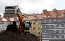 An excavator is used during works at New Nuselska project in Prague