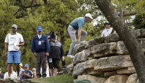 Jordan Spieth climbs rocks to get a better vantage point after an errant drive on the third hole during round-robin play at the Dell Technologies Match Play golf tournament, Thursday, March 28, 2019, in Austin, Texas. (AP Photo/Eric Gay)