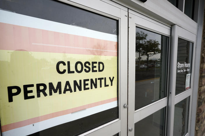 "A business that has closed permanently displays a sign near the entrance, Tuesday, Jan. 12, 2021, in Orlando, Fla. The ""For Rent"" signs on storefronts and offices around the world provide a stark illustration of COVID's toll on small businesses. With government restrictions and fear keeping consumers out of restaurants, stores and other establishments, businesses that operate on narrow revenue streams have struggled the past year. Or, they've disappeared, leaving millions of workers unemployed. (AP Photo/John Raoux)"