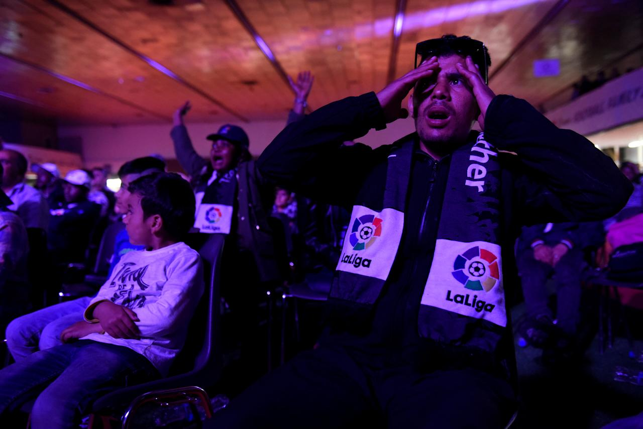 "A migrant reacts as refugees and migrants watch a screening of Spanish first division ""El Clasico"" soccer match between Real Madrid and Barcelona, in the northern city of Thessaloniki, Greece April 23, 2017. REUTERS/Alexandros Avramidis"